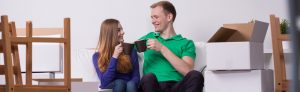Couple-drinking-tea-in-new-house-1